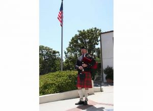 Bagpiper, Eric Rigler, calls the players to the tee for the 12 noon shotgun start.