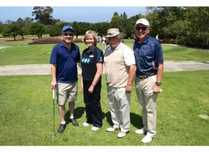 PCCH President, Bette Moen, greats CHLA players Keith Hobbs, Alex Chaves, Sr. and Richard Cordova, CEO of Children's Hospital Los Angeles.