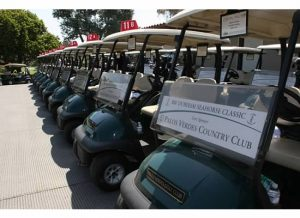 Golf carts lined up to start