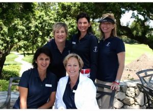 A bevy of beautiful volunteers greeted golfers between the 9th and 18th greens.