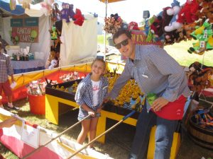 Alexis Lanigan and Jack O'Brien had as much fun working the duck booth as the kids did playing the game!